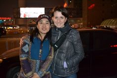 Joan, tour guide in Beijing, and Olha Drobot pose for a photo outside the train station in Beijing.