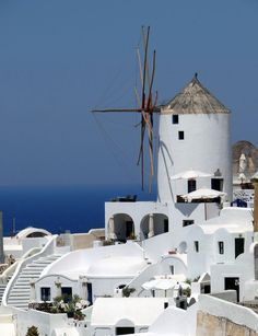 Old windmill in Santorini, Greece (Thira) overlooking the Mediterranean. Places Around The World, Around The Worlds, Old Windmills, Santorini Greece, Archipelago, Cruise, Beautiful Places, Bucket, Explore