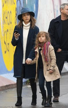 Pretty in the city: The 32-year-old actress was looking smart in a navy coat and fedora beside her equally chic daughter Honor, five