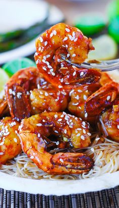 Easy to make shrimp teriyaki over rice noodles.  Teriyaki sauce dressed up with a few simple ingredients! Serve over rice or rice noodles.