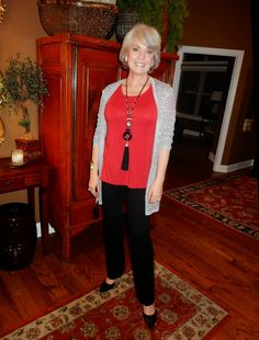 I wore a red Covered Perfectly tunic with a long necklace, silver cuff and Traveler's silver cardigan from Chico's years ago. The Tahari black knit slacks are from Ross a couple of years ago. The black pumps are by Nine West. Fifty, not Frumpy