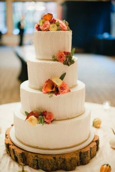 Fall wedding cake topped with ranunculus, calla lilies and succulents // Stephanie Jean Photography // Flowers: Stew Leonard's