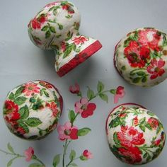 These four little recycled wooden knobs decoupaged in Cath Kidston fabric, but I have done this and decoupaged paper napkins instead of fabric.  I found that it was much easier than using fabric.
