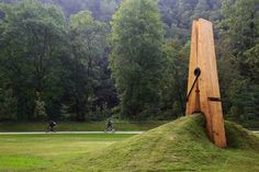 Built for the Festival of the Five Seasons in Chaudfontaine Park, which lies on the outskirts of Liege, Belgium, a giant clothespin sculpture appears to be holding on to a mound of dirt and grass.