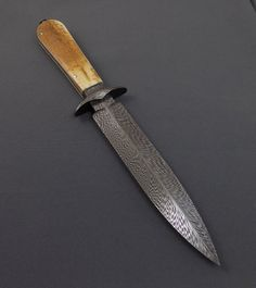 Takedown damascus dagger- feather pattern damascus and mamooth ivory