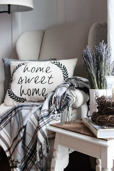 Lovely neutral black and white rustic vintage decor. Love the tartan plaid blanket & Home Sweet Home Pillow. #vintagehomedecor