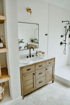 Modern Eclectic Bathroom Remodel - House On Longwood Lane white subway tile bathroom, picture ledge bathroom, free standing tub, american standard cadet tub, Wooden Bathroom Vanity, White Subway Tile Bathroom, Small Bathroom, Bathroom Plants, Gold Bathroom, Bathroom Linen Closet, White Bathrooms, Wood Vanity, Black Bathroom Vanities