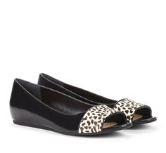 even cuter than plain black flats, these peep toe flats have a bit of animal print to keep things interesting