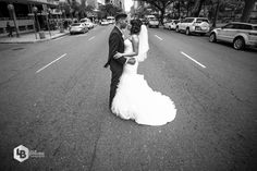 Romance in the middle of the street. I love the look of an urban wedding.
