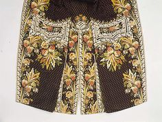 Back view, detail embroidery, court coat, probably France, 1775-1785. Brown silk velvet, lavishly embroidered with naturalistic flowers in coloured silk.