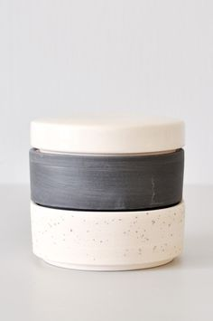 Modern porcelain stacking vesselfrom ceramicist Ben Fiess. Lid is glazed white, one stacking level in matte grey speckle and the other in matte black. Use as
