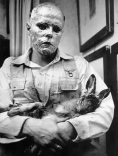 Joseph Beuys. A piece of performance art involving a dead hare.