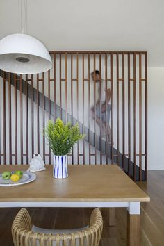 modern wooden screen to cover the staircase and make the dining area cozier