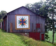 Quilt Barn.  Mariner's Compass Quilt Pattern: the first quilt block to be painted near the Ohio River. This block represents the River Heritage of our county. -