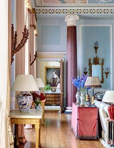 Mark Gillette designs interiors for Burley-on-the -Hill (England). Three hundred years old, the interiors are in the Robert Adam style. Gillette had details painted to evoke not only Adam, but Wedgwood. Ceramic lamps on the left: Vaughan.