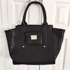 I just discovered this while shopping on Poshmark: 3.1 Phillip Lim for Target Black Large Satchel. Check it out!  Size: OS