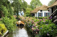 Those seeking a reprieve from city life will find the serenity of simpler times in Giethoorn. Instead of roads, the car-free village has miles of canals, so the primary means of transport is by boat. Float down the narrow canals, past thatched-roof farmhouses and cottages encircled by blooming gardens, and beneath dozens of wooden bridges that connect each grassy plot of land. Or return in the winter, when ice skaters glide on the frozen canals.