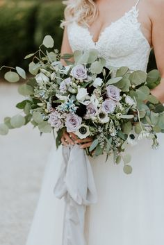 Lush bridal bouquet with lavender roses, anemones, eucalyptus, and ranunculus Light grey silk ribbon by Adorn Company Rustic Oyster Themed Eastern Shore Maryland Outdoor Wedding by East Made Event Company Wedding Planner and Bekah Kay Creative907 (1).jpg