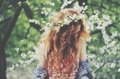 pink ombré curly hair with a flower crown