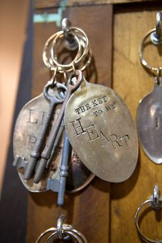 flattened stamped spoon keychains - love the skeleton key with these! #upcycle #repurpose #keychain #key #chain #spoon #bowl #flat #flattened #stamped #word #stamp #skeleton #patina #saying - ≈√