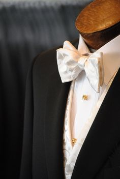 Canali notch lapel tuxedo, with an ivory paisley Dion vest  and bow tie. David Donahue gold knot to compliment.