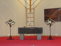 These black wrought iron candelabras have enclosed floating candles so they can be used at the reception. We attached arrangements of white stock, orchids and hot pink roses.