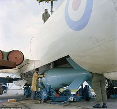 Prepared: Armourers load a dummy Yellow Sun Mark 2 into the bomb bay of a Victor B1A durin...