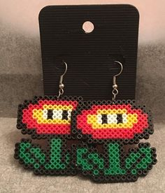 These cute earrings are made from mini Perler beads and measure about 4 cm long. Perfect for any fan! We do use a more melted look on the one side which makes the characters nice and strong, the other side will have a more pixelated look. That way you can turn them either way- depending