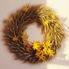 Fall Wheat Wreath: Tuck leaves into a wreath made of wheat or thistles from a field. Simply slip the stems of the leaves into the spaces between the wheat heads. Use the leaves sparingly so their individual shapes pop against the neutral background. When the leaves fade, remove them, and save the wreath for next year.