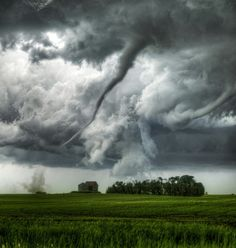 Slim tornado coming over this landscape.