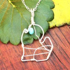 This Michigan Pendant has been customized with a turquoise bead to feature Torch Lake north of Traverse City. Available in my Earth Jewelry store on Etsy.  #michiganmade #michigan #michigander #michiganawesome #michiganlove #michiganlake #torchlake #torchlakemichigan #traversecity #traversecitymichigan #earthjewelry #michiganjewelry #ilovemi
