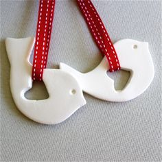 Listing is for 2 tags Sweet and simple Scandi designed bird ornaments with a heart shaped wing cutout. Perfect for your christmas tree, wreath, gifts or home decor.. Handmade from white airdry clay, painted and glazed and come finished with a white stitched crossgrain ribbon. Dimmensions approx 6 cm x 4cms