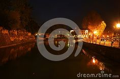 Sile river in Treviso city by night, Veneto, historical buildings on both sides.