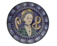 Plate  Italian, Rome, painted by Torquato Castellani, 1872   Earthenware, tin glaze   National Museum Of Scotland, A.1874.2.4     Maiolica dish painted with the portrait of a lady on a blue ground, with an inscribed scroll behind her and border decorated with foliage and fruit.