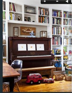 piano surrounded by books.  love.