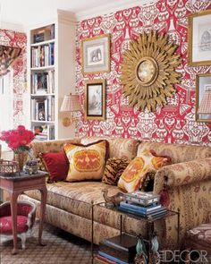 "JUST AMAZING! #interiordesign ""In my own apartment, I've used red everywhere: on upholstery and curtains, objects, and lampshades,"" says Papachristidis. ""In my library, I used a bold red and white wallpaper with Chinese vases; I also used red as an accent on the daybed fabric and pillows. This room uses a lot of tobacco, a color that looks chic with red."""