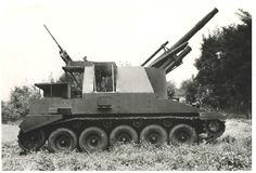 """Lorraine 155 mle. 50 - In 1950, Lorraine started the development of its own self-propelled gun. Lorraine's engineers proposed two different concepts on the same chassis, although at certain point of the development even a wheeled chassis was considered as an alternative to the tracked one.  First prototype, marked as """"model 1950"""" had its howitzer mounted in the centrally placed casemate, while the """"model 1951"""" had the structure pushed to the front of the veichle."""