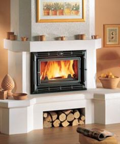 If you want to buy a wood stove, a cheap wood burning stove can deliver excellent home heating. This page considers the options for cheap wood burners. Fake Fireplace, Wood, Home, Stove, Dream Cottage, Cheap Wood Burning Stoves, House, Building A House, Modern Fireplace