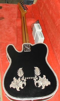 this is a killer guitar! started life as a nice vintage style Mexican Fender Tele.......now the only thing that is original to that guitar are the body, neck and tuners.......here are the Custom Features and changes! Custom Grade A Hand Tooled Leather wrap, Custom Hand engraved El Dorado(Bridge/n...