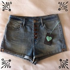NWT Kendall and Kylie Size 7 Shorts These trendy, size 7 Kendall and Kylie shorts are brand new with tags. They have 5 buttons down the front and rolled cuffs on the bottom. They are in perfect condition and are great for the summer! Kendall & Kylie Jeans