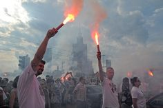 People hold flares to commemorate the 69th anniversary of the beginning of the 1944 Warsaw Uprising in Warsaw, Poland. Thousands of young city residents opened an uneven struggle on Aug.1, 1944, against the Nazis and the advancing Soviet Red Army.