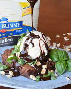 This Sweet Basil Brownie Sundae combines a warm homemade brownie with vanilla ice cream, hot fudge, toasty hazelnuts and fresh basil. The basil gives the sundae a sweet and spicy summery kick! #SunsOutSpoonsOut #ad