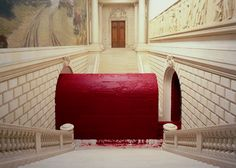 """Svayambh,"" by Anish Kapoor, in which a giant mass of red wax was guided along a track through the Royal Academy of Arts, changing shape as it passed through differently sized arches and doorways (2009)."
