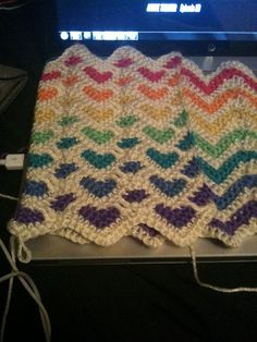 Reversible sweetheart and ripple afghan in rainbow colours. Original pattern on Ravelry called Sweetheart Ripple