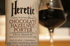Name: Chocolate Hazelnut Porter Brewery: Heretic, California, US ABV: 7% Style: Porter - If you want hazelnut then it's in this bottle by the truckload! Huge, creamy [vanilla?] hazelnut dominates the aroma and taste, ably supported by a choc and coffee base along with echoes of grassy hop and dabs of brown sugar. It's light bodied and the prickly carbonation lifts what bitterness exists before the drying finish. After all that, this comes across as a well made one-trick pony. [7.5]…