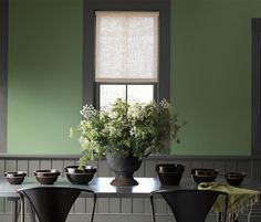 An elegant dining space made inviting by the combination of traditional paint colors Palace Green and Geddy Gray from the Benjamin Moore Williamsburg® Paint Color Collection. Walls: Palace Green Natura®, Flat // Trim & Wainscoting: G Green Paint Colors, Green Colour Palette, Wall Colours, Dark Trim, Grey Trim, Living Room Green, Green Rooms, Green Dining Room Paint, Interior Paint