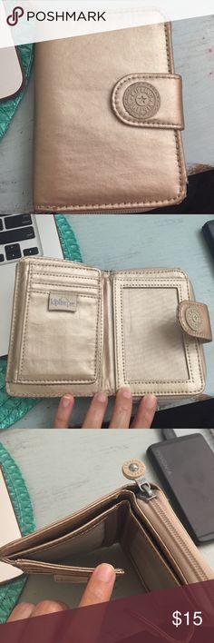 Kipling wallet Kipling wallet  in beige gold. Really cute that fits coins, cards, and cash. Kipling Other