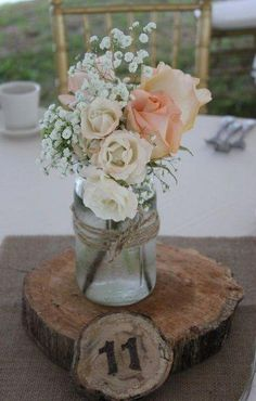 Tiffany peach roses, majolica spray roses and babies breath in a mason jar for a lovely summertime wedding. Tiffany peach roses, majolica spray roses and babies breath in a mason jar for a lovely summertime wedding. Wedding Table Decorations, Wedding Table Numbers, Wooden Table Numbers, Tiffany Rose, Tiffany Wedding, Mason Jar Centerpieces, Mason Jar Flower Arrangements, Mason Jar Flowers, Floral Centerpieces