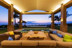 Tropical patio cabana with amazing views and comfortable furniture.