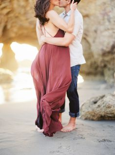 Romantic burgundy coastal engagement session: http://www.stylemepretty.com/little-black-book-blog/2015/11/11/el-matador-coastal-engagement-session/ | Photography: Sally Pinera - http://sallypinera.com/
